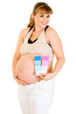 Happy pregnant woman holding color paint samples Stock Photography