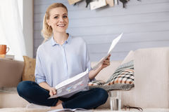 Happy pregnant woman holding documents Royalty Free Stock Photos