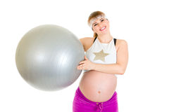 Happy pregnant woman holding fitness ball Stock Images