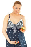 Happy pregnant woman holding piggy bank Stock Photography