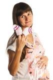 Happy pregnant woman holding small socks Royalty Free Stock Photos