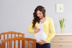 Happy pregnant woman. Indoor shoot stock photos