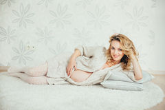 A happy  pregnant woman Stock Images