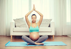 Happy pregnant woman meditating at home Royalty Free Stock Photo