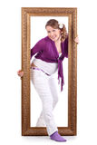 Happy pregnant woman out of large carved frame Stock Photography