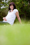 Happy Pregnant Woman in Park Stock Image