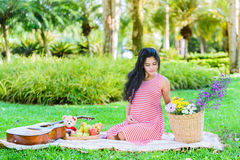 Happy pregnant woman picnic. In the park Royalty Free Stock Images