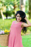 Happy pregnant woman picnic in the park. On green background Royalty Free Stock Photo