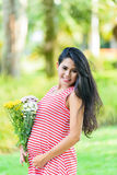 Happy pregnant woman picnic in the park. On green background Royalty Free Stock Photography