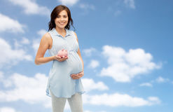 Happy pregnant woman with piggybank Royalty Free Stock Image