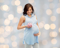Happy pregnant woman with piggybank Stock Photo