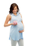 Happy pregnant woman with piggybank Stock Photos