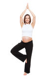 Happy pregnant woman practicing yoga Stock Image