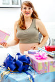 Happy pregnant woman with presents for her baby Royalty Free Stock Image