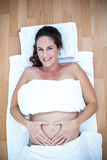 Happy pregnant woman relaxing at home Stock Photography
