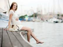Happy pregnant  woman in sea port Stock Photo