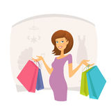 Happy pregnant woman with shopping bags Royalty Free Stock Images