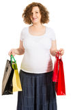 Happy pregnant woman at shopping. Holding bags isolated on white background Royalty Free Stock Photo