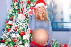 Happy pregnant woman in Christmas eve Royalty Free Stock Photos