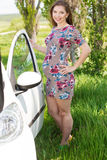 Happy pregnant woman standing near car Stock Image