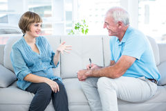 Happy pregnant woman talking to gynaecologist Stock Image