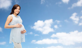 Happy pregnant woman touching her big belly Royalty Free Stock Image