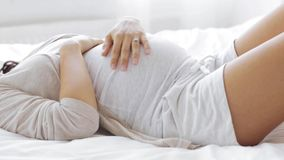 Happy pregnant woman touching her tummy at home 42 stock video footage