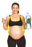 Happy pregnant woman with water Stock Photos