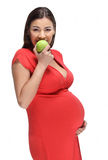 Happy Pregnant Woman With Apple Royalty Free Stock Photos