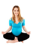 Happy Pregnant Woman in Yoga Pose Royalty Free Stock Image