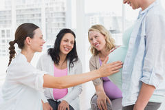 Happy pregnant women at antenatal class. At the hospital Stock Photo