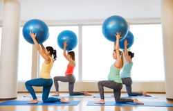 Happy pregnant women exercising with ball in gym Stock Photography
