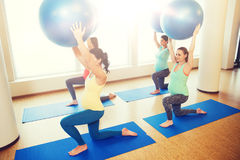 Happy pregnant women exercising with ball in gym Stock Photos