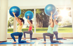 Happy pregnant women exercising with ball in gym Royalty Free Stock Images