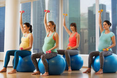 Happy pregnant women exercising on fitball in gym Royalty Free Stock Photography