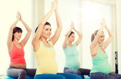 Happy pregnant women exercising on fitball in gym Royalty Free Stock Photo