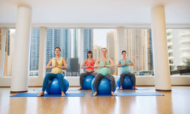 Happy pregnant women exercising on fitball in gym Royalty Free Stock Photos