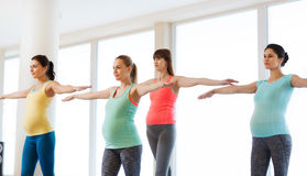 Happy pregnant women exercising in gym Royalty Free Stock Images