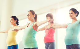 Happy pregnant women exercising in gym Royalty Free Stock Image