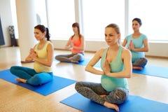 Happy pregnant women exercising at gym yoga royalty free stock photos