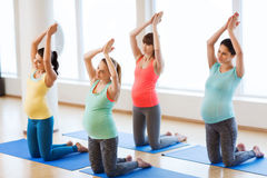 Happy pregnant women exercising on mats in gym Royalty Free Stock Photography