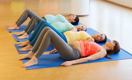 Happy pregnant women exercising on mats in gym Royalty Free Stock Image