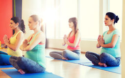 Happy pregnant women exercising yoga in gym Royalty Free Stock Image