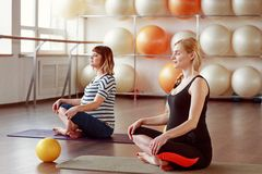 Expectant women in yoga center royalty free stock image
