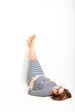 Happy pregnant women rests on floor legs up Stock Photos