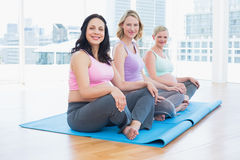 Happy pregnant women sitting in yoga class Royalty Free Stock Photo