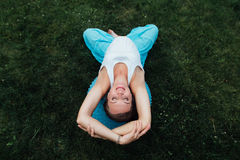 Happy pregnant yoga prenatal maternity doing different exercises with fitball. in park on the grass,Pilates. top view. Happy pregnant yoga prenatal maternity Royalty Free Stock Photo