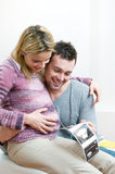 Happy pregnant young couple with baby sonogram Royalty Free Stock Photos