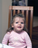 Happy preschool girl in chair Stock Photo