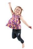 Happy preschool girl jumping. Happy preschool girl or toddler jumping for joy; isolated on white background Royalty Free Stock Photos